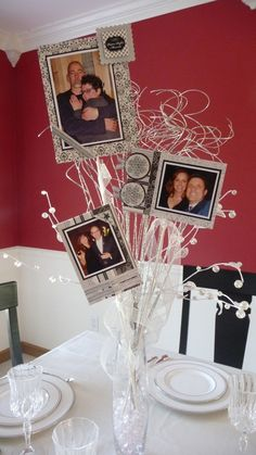 Attach photos to wooden skewers, cut to varying heights, and secure them inside a vase or other decorative holder. Use any accents you would like to make it seem more festive. I would strongly recommend using black and white or sepia colored photographs. If you have photos on a disk or flash drive, you can get them printed at stores, such as Walmart, for as little as 20 cents per photo.