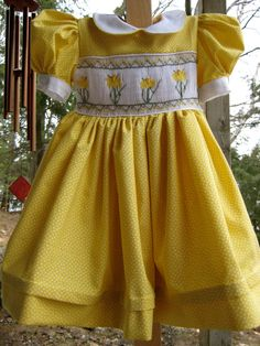Spring dress--The daffodil design plate came from an issue of Sew Beautiful. Smocking Plates, Smocking Patterns, Girls Smocked Dresses, Little Girl Dresses, Smocking Tutorial, Heirloom Sewing, Smock Dress, Baby Sewing, Baby Dress