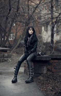 """Bucked knee-high platform boots, leggings, black jacket"" 