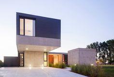 Amado Cattaneo Arquitectos - Casa estilo actual racionalista - Portal de Arquitectos