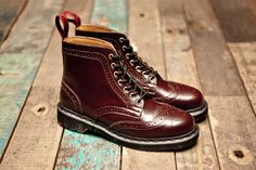 Dr Martens Brogue boots...I think the lady or the gentleman could pull them off!