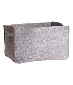 Product Detail | H&M US- felt storage box.  I'm pretty sure I could whip up a couple of these without too much trouble.  Shoot, I could even hot glue it.
