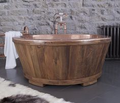 Tub of hand beaten copper and wood cladding - either American Oak or Teak