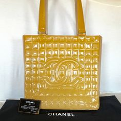 Chanel Large Quilted Patent Leather bag Authentic Chanel Large Quilted Patent Leather handbag color is golden creamy color....light scuff on one side but other than that it is like new inside and out! The signature lamb skin leather lined under straps and the zipper straps. The thick double handles are flawless! Original dustbag and Authenticity card. Price is firm CHANEL Bags Shoulder Bags