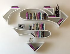 22 Creative Bookshelves Guaranteed to Give You Shelf Envy Who doesn't love superman decor? These creative floating bookshelves are definitely super. Creative Bookshelves, Floating Bookshelves, Bookshelf Ideas, Bookshelf Design, Wall Shelves, Shelving, Book Shelves, White Shelves, Deco Originale