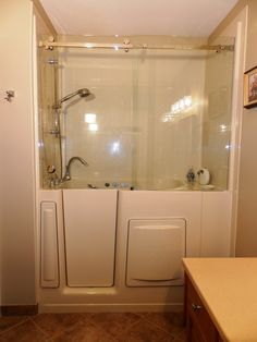 Escape Plus Walk-in Bathtub with 3 wall composite surround, extension and top-hung sliding glass shower doors. www.aquassure.com