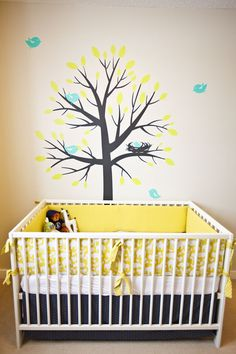Somehow the word got out that the twins room is going to be Yellow & Grey and that I have been having a hard time finding those colors in baby gear. So happy to find another nursery for inspiration!