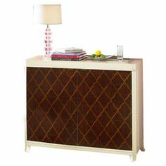 """Hand-painted bar with quatrefoil marquetry and interior bottle and stemware storage.  Product: Bar cabinetConstruction Material: WoodColor: Ivory and walnutFeatures:  Hand-applied finishOgee patterned laid marquetry found of door fronts Dimensions: 41"""" H x 49"""" W x 19"""" D"""