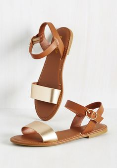 If it's these vegan faux-leather sandals that are up for debate, you'll give them a definite 'yes' when you see 'em in the sun! Their metallic gold toe bands and matching buckles shine under the rays, while their cognac ankle straps make crafting infinite outfits a cinch!