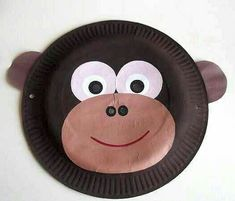 paper plate monkey mask *paint your paper plate in brown to represent a monkey *Add eyes and a eyes *stick a different colour of brown (lighter shade than the paint) paper on the front for the nose and mouth *Now you can draw your nose and mouth Jungle Crafts, Zoo Crafts, Monkey Crafts, Animal Crafts For Kids, Toddler Crafts, Preschool Crafts, Fish Crafts, Preschool Christmas, Christmas Crafts