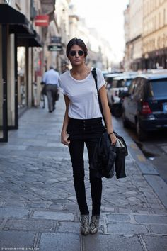 classic.  simple white tee, skinnies, statement shoe, leather and rayban style shades.