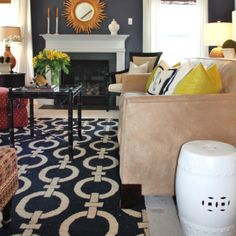 Must have the tan couch with navy rug and bright yellow accent pillows!