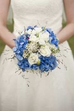 Add color to your wedding bouquet with blue flowers.