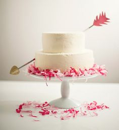 Bow and arrow pink and white wedding cake