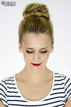 As far as pretty and easy hairstyles go, topknots take the cake! Put a spin on your typical bun by starting with a loose fishtail braid, like this one by blogger and hairstylist Steph Brinkerhoff. The finished look has body and texture that will hold up through the ceremony, photos, and reception.