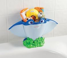 Disney Mr. Ray Bath Scoop & Organizer by Disney. $32.69. Mr. Ray character from popular Finding Nemo movie; Large capacity storage area holds off of baby's bath items.  Base designed to sit comfortably on tub side ledge with additional suction cup for added tub side support.  Sturdy handle allows for easy scooping of bath toys, making clean up a breeze.  Large drain holes for ventilation & allows toys to drip dry.