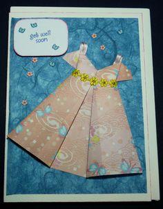 Handfolded origami dress card.