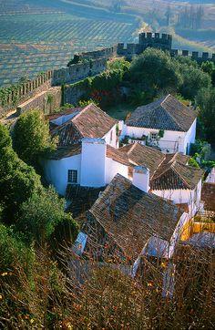 Óbidos medieval town - Portugal. North of Lisbon started as a Roman city. There are still some remains of Roman structures. After 713 the Mours took over remained until in 1148 the 1st Portuguese king conquested it .