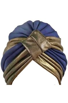 Add a touch of glitz to your look with this sharp looking two-tone pleated turban.� The pleats of this unique turban are gathered at the front by an eye-catching metallic fabric. Turban crown is 7 inc