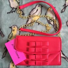 Betsy Johnson crossbody hot pink bag bows fuchsia Brand new with tags. Hot pink cross body. Very light unnoticeable scuff on inside shown in pic  fits an iPhone 6 and may also fit a 6plus. Original cost $68 Betsey Johnson Bags Crossbody Bags