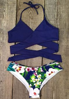 Take a step out of the door in the hot bikini and you'll want to spend the day on the beach! Make sure to add this Cross Floral Bikini to your collection, it definitely is a must have!