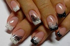 Black and White polka dot French tip nail with Butterfly. This is quite pretty with the different design for each finger. Love it!