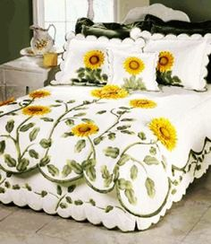 Not keen on the sunflowers, but I love the holistic approach to the quilt, valance and pillow shams, and the way the quilt design grows from the bottom. Also the scalloped edge.Sunflower Quilts I could make a quilted dust ruffleSunflower Quilts would Sunflower Quilts, Applique Quilts, Bed Sets, Bed Covers, Bed Spreads, Quilting Projects, Comforter Sets, Quilt Patterns, Bedroom Decor