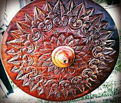 Decorative wheel carved like the ox cart decorations.