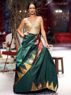 Designer: Monisha Jaisingh for India Couture Week.... Loved the way she integrated South Indian temple border into a western cut evening gown