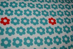 Turquoise With Red Flower On White Fabric by LavenderNThyme
