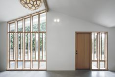 """""""The bank of full-height windows brings in tons of southern light, but it also gives the stable a strong street presence, and it ties into the stick-built window pattern already established at the entry to the main house,"""" Schaer says. The locally-sourced Douglas fir windows and doors were provided by Lindal Cedar Homes."""