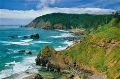 Ecola State Park -- Directly north of Cannon Beach -- Offers sweeping coastal views of the iconic sea stacks along Cannon Beach.  It's also the best location to view Tillamook Rock Lighthouse, perched atop a rocky outcrop a mile out at sea.  Visitors can explore miles of trails along the exposed headland at Ecola State Park, including hikes to either Indian Beach or Crescent Beach.