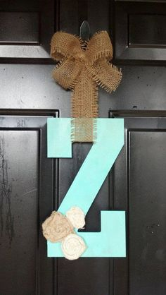 Rustic Initial with Burlap Rosettes & Bow. $21.00, via Etsy.