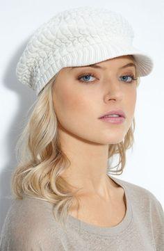 Cream knit newsboy hat.