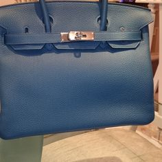 LXRandCo guarantees this is an authentic vintage Hermès Birkin 35 SHW Bleu  Tempete handbag. Crafted in togo leather 07adc902b58ff