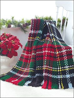 A crochet tartan? Awesome!     Ravelry: Holiday Tartan Afghan pattern by Jenny King
