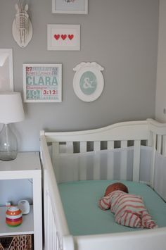 Love this decor but this baby should be on her back, not her belly....
