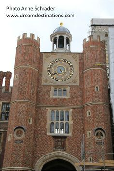 Anne Boleyn's Gate. The Tudor gatehouse and astronomical clock, made for Henry VIII in 1540. Hampton Court Palace England  Still functioning, the astrononical clock shows the time of day, the phases of the moon, the month, the quarter of the year, the date, the sun and star sign, and high water at London Bridge (useful for visitors to return to London).