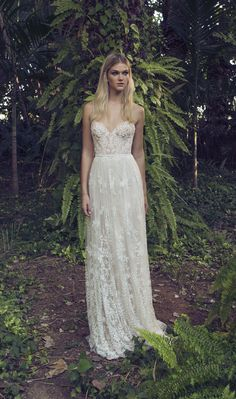 Beautiful floaty layered wedding dress covered in layers of floral patterned lace Clover by Limor Rosen (Exclusively Available 20th - 22nd January)