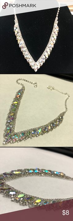 Silver Tone Rhinestone Necklace Sparkle Delight! The large, Marquis cut Rhinestones are a Plastic but you would never know it by looking at them sparkle. The small ones, are real Rhinestones Jewelry Necklaces