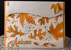 Thanksgiving 2016 Hammered cardstock panels popped, Darice EF, Tim Holtz leaf stencil ithe Distress Inks, IO leaf dies, Unknown Autumn die, Faux dots made with circle punch and stylus. Created by Peggy Dollar
