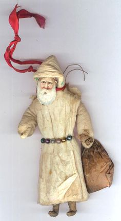Cotton Santa with scrap face and blown glass bead belt. lt 19th c Germany