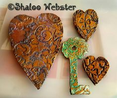 Antiqued heart shapes and a key made out of cardboard for my mixed media art work xx     www.shaloowebster.com