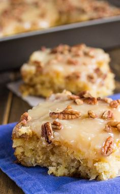 """Flavored and moistened with crushed pineapple and topped with a sweet icing laced with shredded coconut, and sprinkled with pecans is a wonderful dessert to make to feed a crowd."""