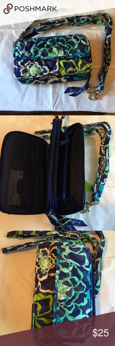 All in one crossbody for I phone 6 Katalina Blue pattern, 3 compartments one for phone, one for credit cards and ID, one for money with zip section for change. Can be used as crossbody or wristlets. NWT Accessories