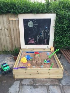 Homemade sandpit using decking board and a blackboard lid                                                                                                                                                                                 More