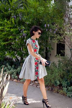 Love the way she mixes a sweet vintage dress with modern, edgier accessories.