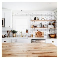The tiles and the wood counter are great contrast but still creating perfect harmony.