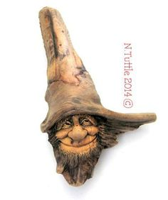 """""""Pleasant Pleasures""""   This sweet spirit of driftwood measures 8¼ inches  tall and 4¾ inches across the brim of his hat.   Signed and dated:  N. Tuttle 4/1/14"""