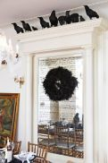 Crow Décor and Black Feathered Wreath – shared on Midwest Living